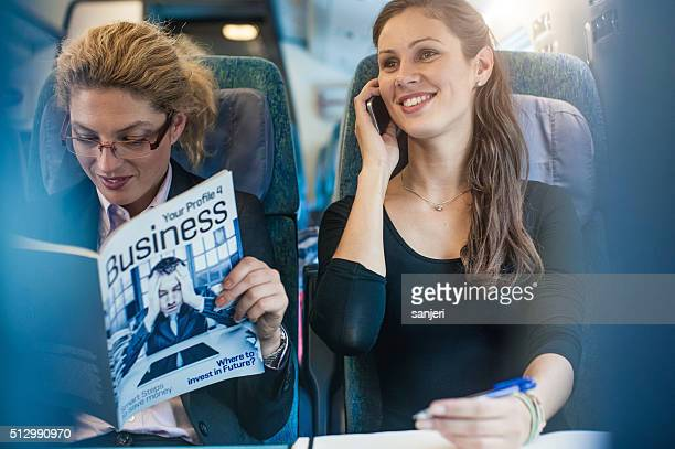 Businesswoman having meeting on the train