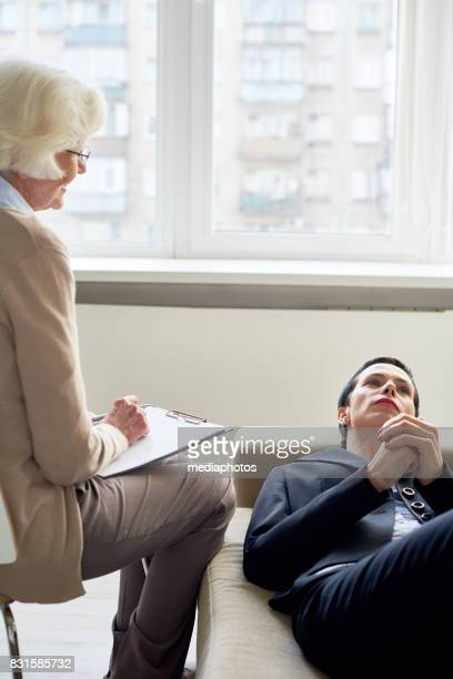 businesswoman having mental health problems - psychiatrist's couch stock pictures, royalty-free photos & images