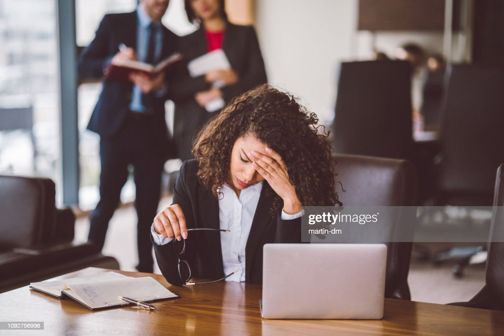 Businesswoman having problems in the office : Stock Photo