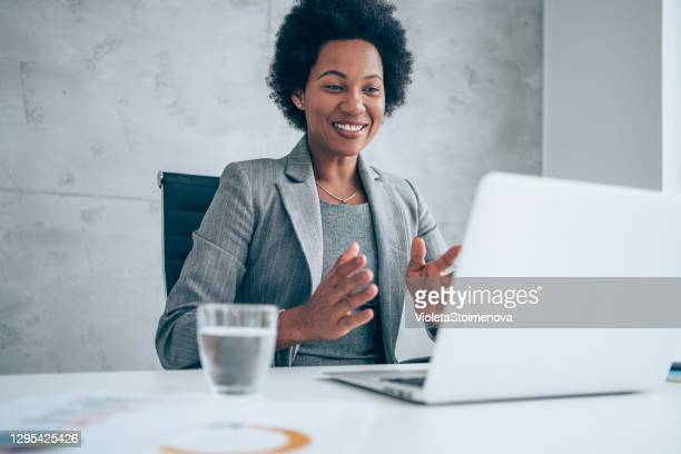 businesswoman having video call in the office. - leadership stock pictures, royalty-free photos & images