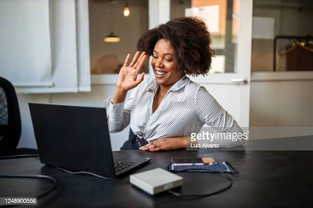 businesswoman having video call meeting in office - gesturing stock pictures, royalty-free photos & images