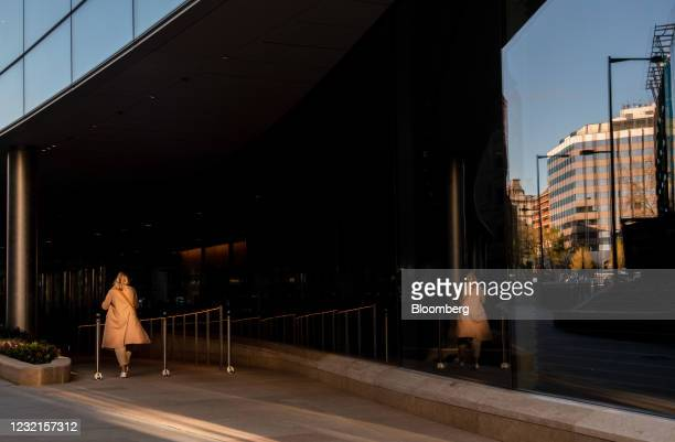 Businesswoman heads towards the European headquarters of Goldman Sachs Group Inc. In London, U.K., on Wednesday, April 7, 2021. Hundreds more...