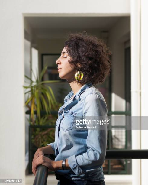 young woman during few daily moment - north african ethnicity stock pictures, royalty-free photos & images