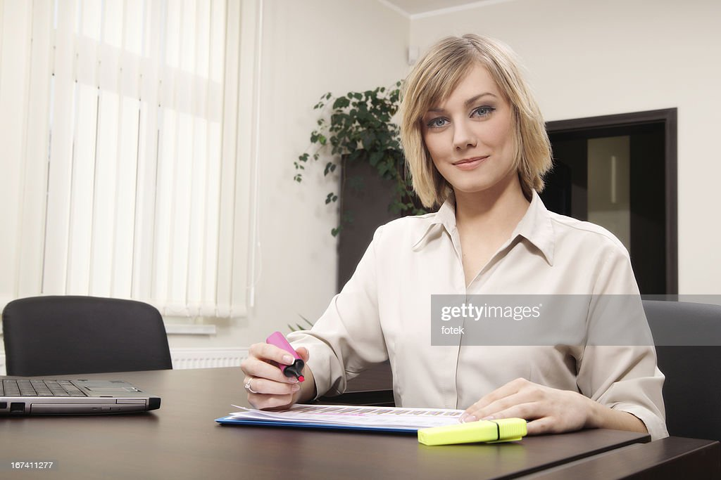 Businesswoman highlighting text : Stock Photo
