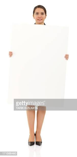 Businesswoman holding a billboard