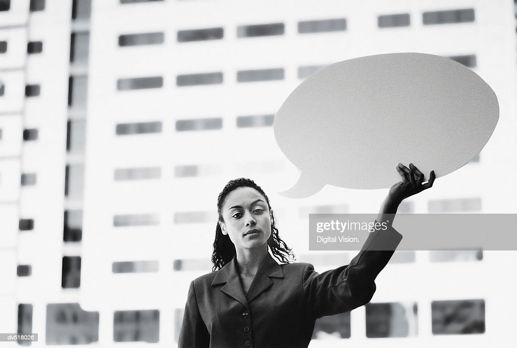 Businesswoman holding a blank message bubble : Stock Photo