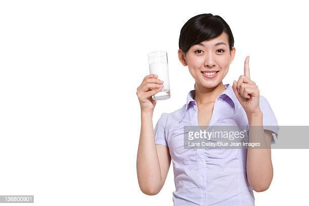 Businesswoman Holding a Glass of Milk