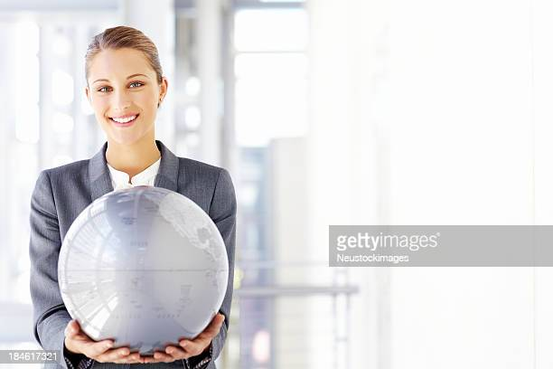 Businesswoman Holding a Large Globe