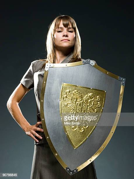 businesswoman holding a shield