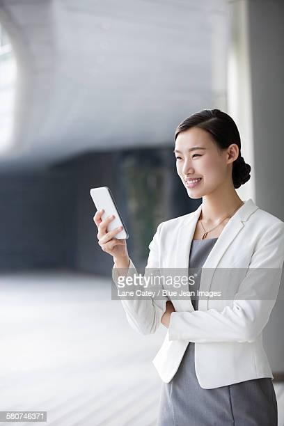 Businesswoman holding a smart phone