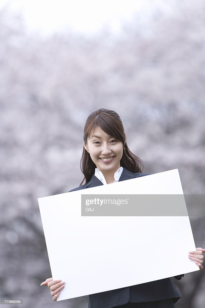 Businesswoman Holding a White Board, Head and Shoulder, Front View, Differential Focus : Photo