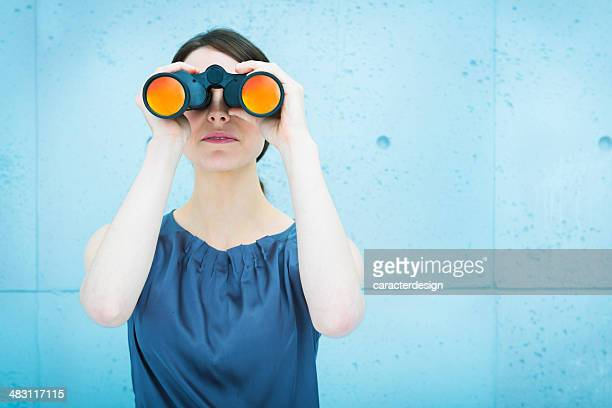 businesswoman holding binoculars - curiosity stock pictures, royalty-free photos & images
