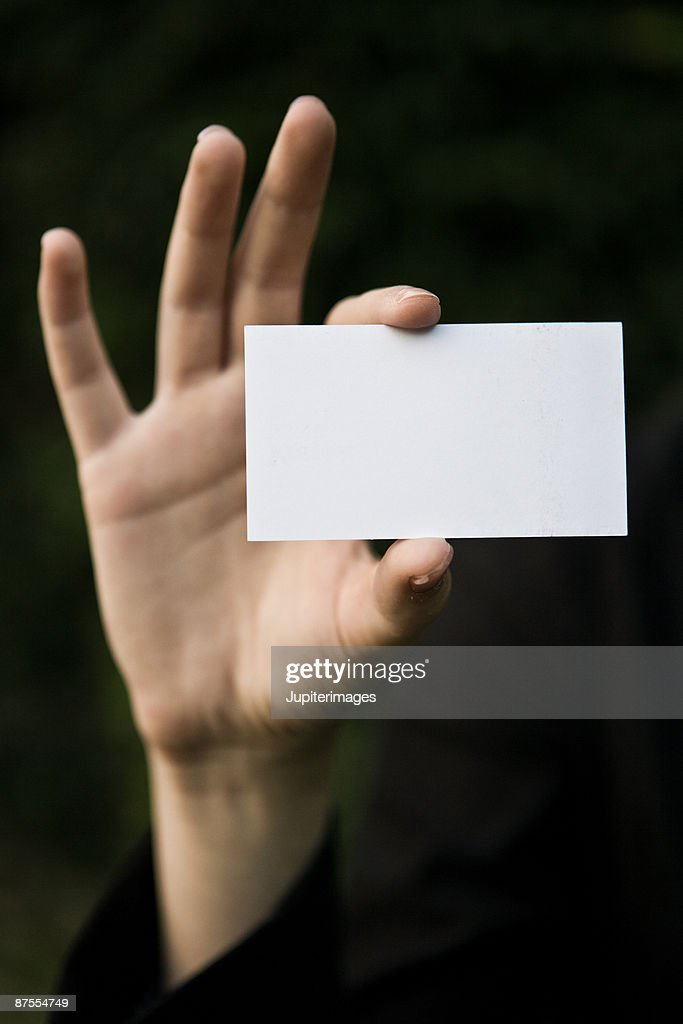Businesswoman holding blank business card stock photo getty images businesswoman holding blank business card stock photo reheart Gallery