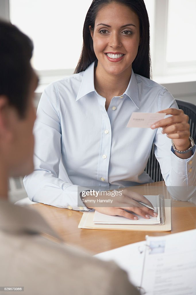 Businesswoman holding business card : Stock Photo