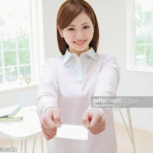 Handing out business cards stock photos and pictures getty images businesswoman holding business card colourmoves