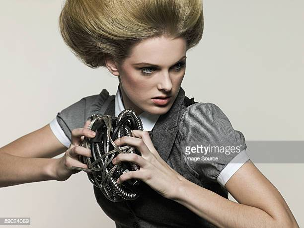 Businesswoman holding cable