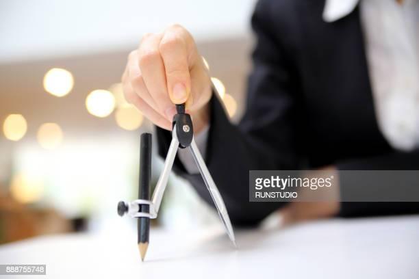 Businesswoman holding compass