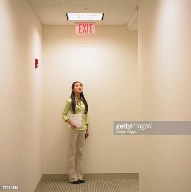 Businesswoman holding documents in a corridor