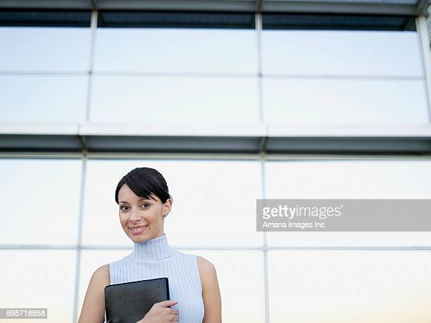 Businesswoman Holding File by Office Building