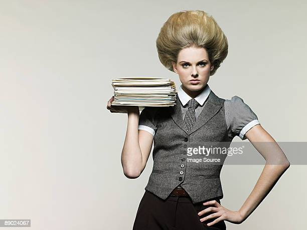 businesswoman holding files - beehive hair stock pictures, royalty-free photos & images