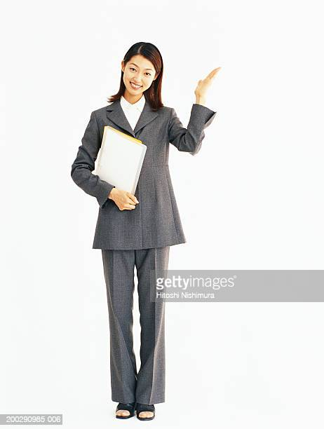 Businesswoman holding files, portrait