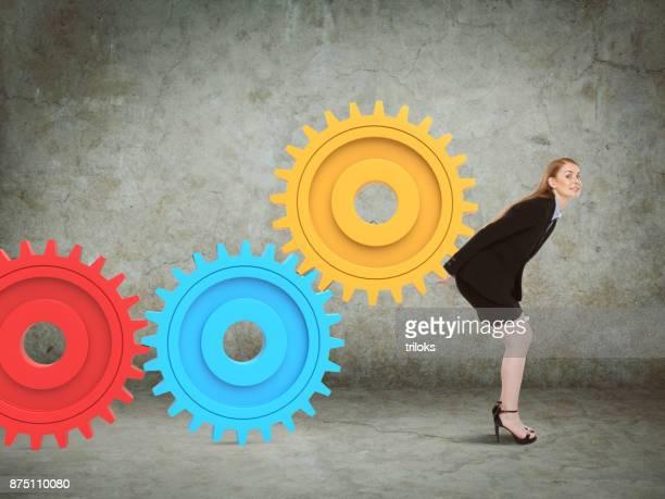 Businesswoman holding gear