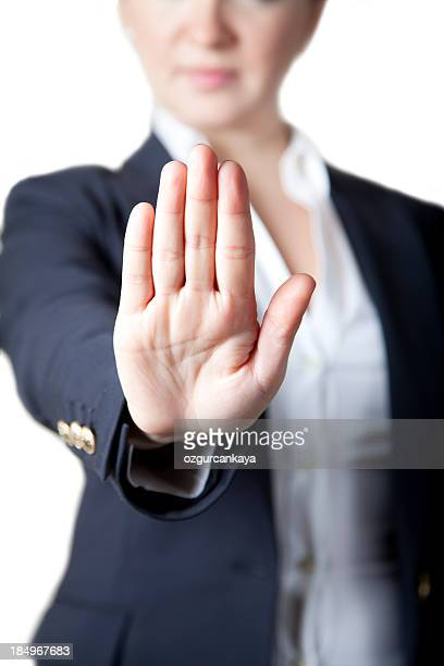 Businesswoman holding hand up in stop hand symbol