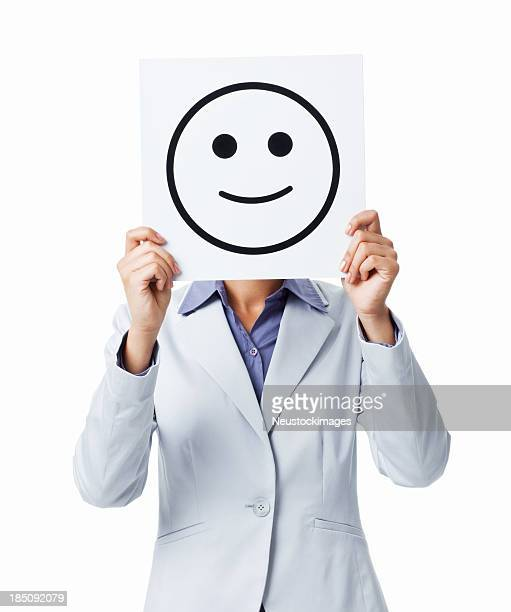 Femme d'affaires tenant heureux de Smiley Sign- isolé