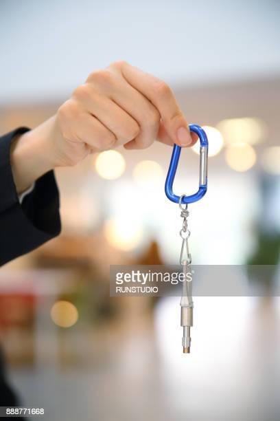 Businesswoman holding key ring