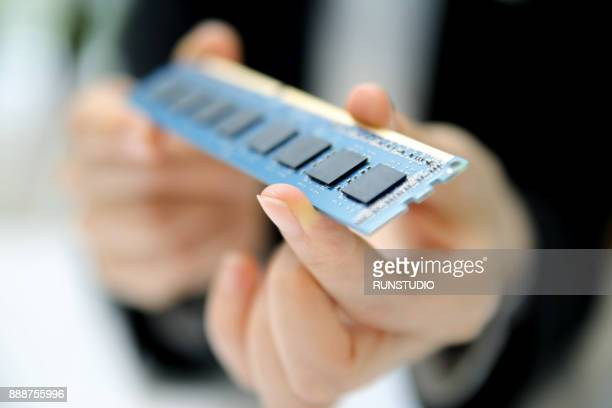 Businesswoman Holding memory chip