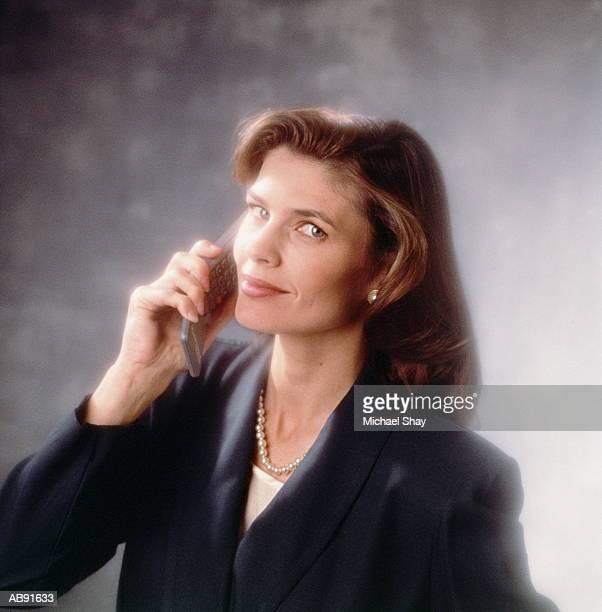 Businesswoman holding mobile phone, portrait