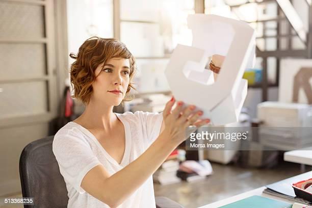 Businesswoman holding model