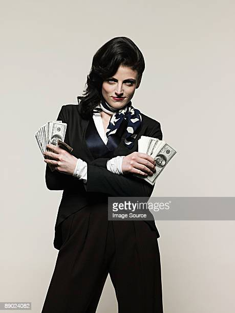 businesswoman holding money - smug stock photos and pictures