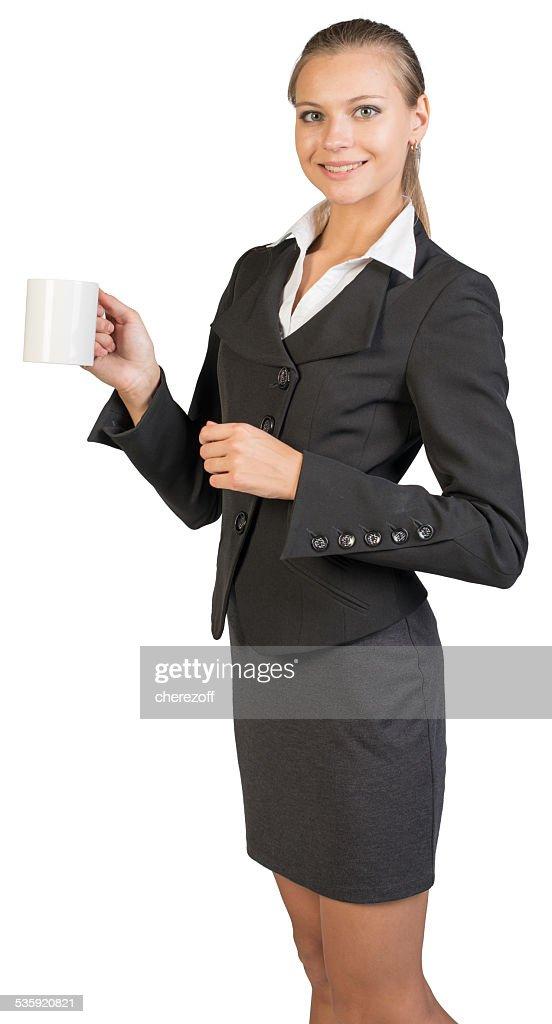 Businesswoman holding mug : Stock Photo