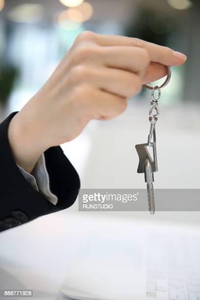 Businesswoman holding padlock and key