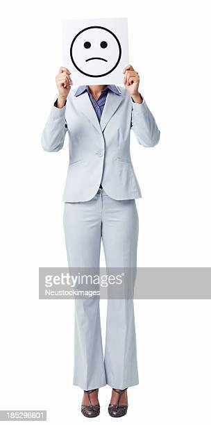 Businesswoman Holding Sad Smiley Face Sign - Isolated