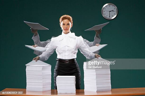 Businesswoman holding sheets of paper, portrait