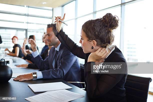 businesswoman holding up and at meeting - festlich gekleidet stock-fotos und bilder