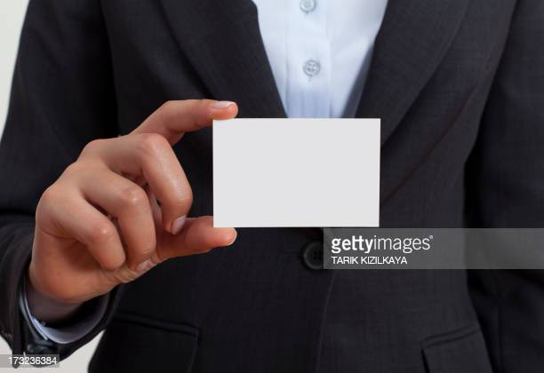 Businesswoman holding white business card