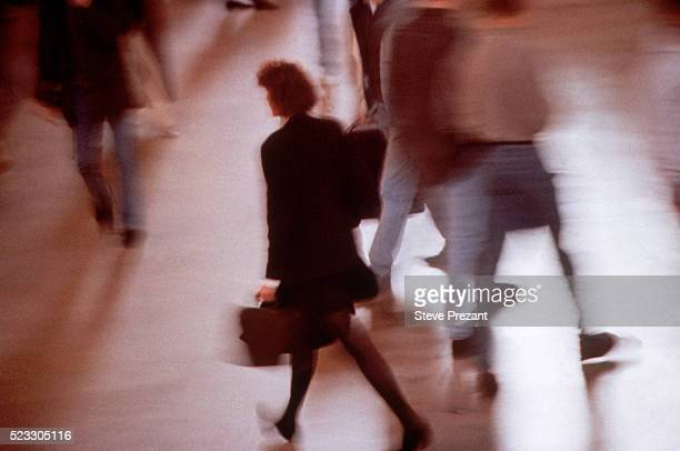 Businesswoman Hurrying through the Lobby