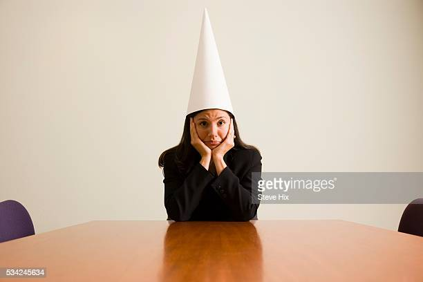 Businesswoman in a Dunce Cap
