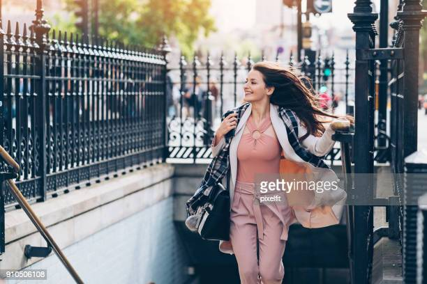 businesswoman in a hurry - beat the clock stock photos and pictures