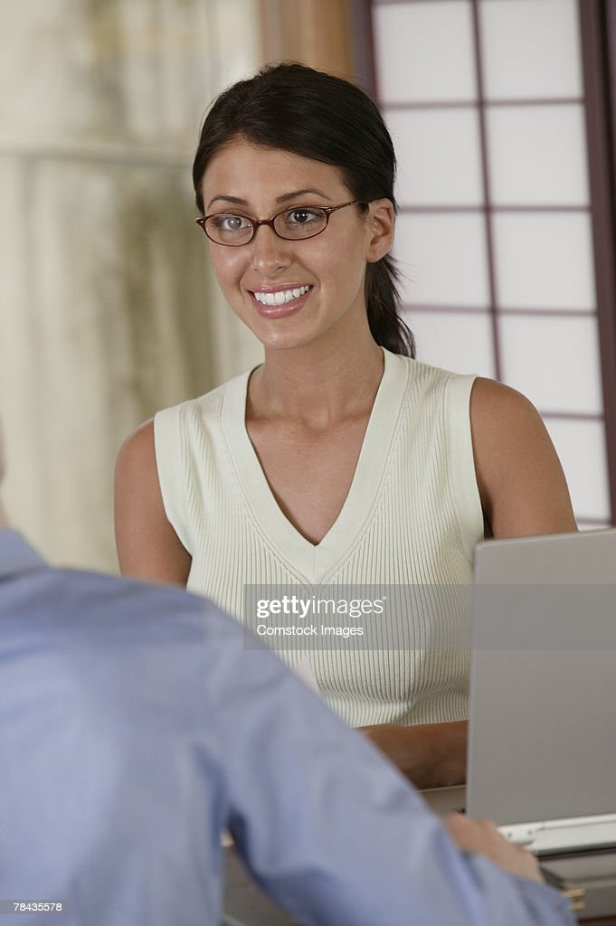 Businesswoman in a meeting : Stockfoto