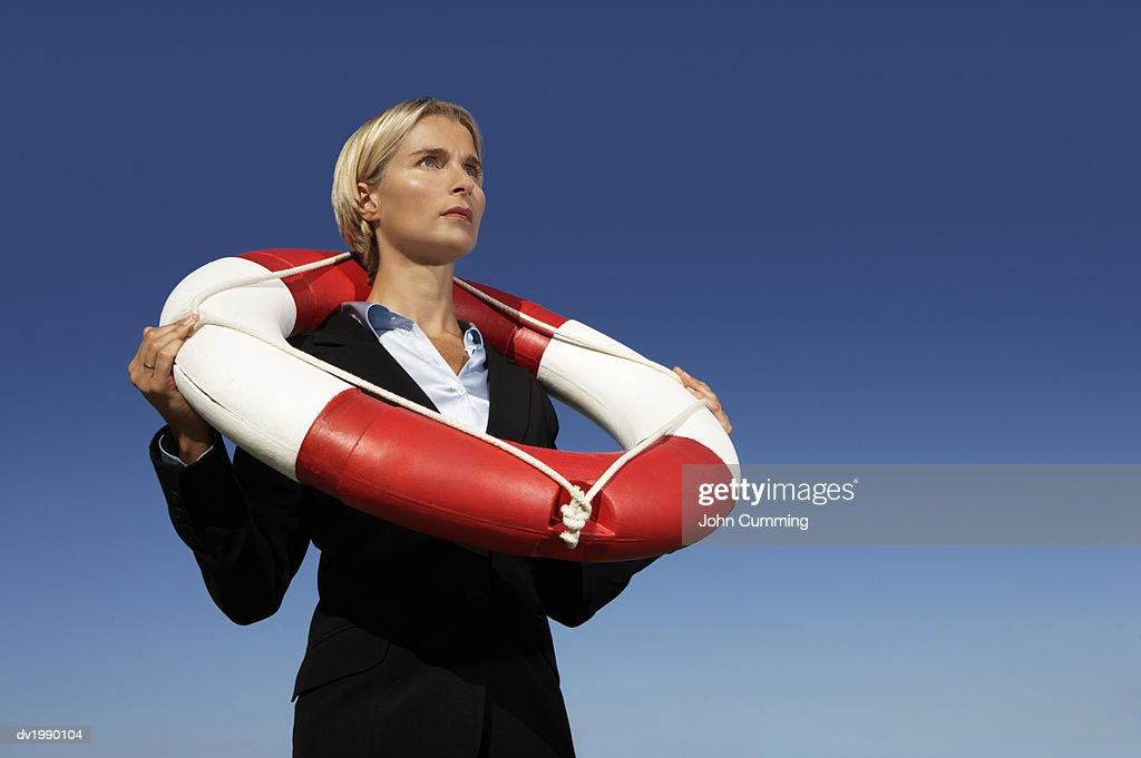 Businesswoman in a Suit Wearing a Life Belt : Stock Photo