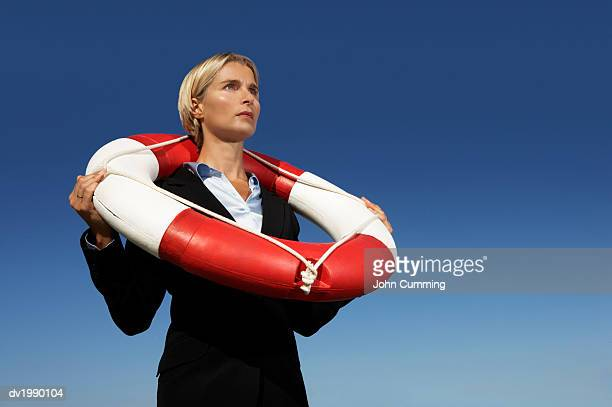 Businesswoman in a Suit Wearing a Life Belt