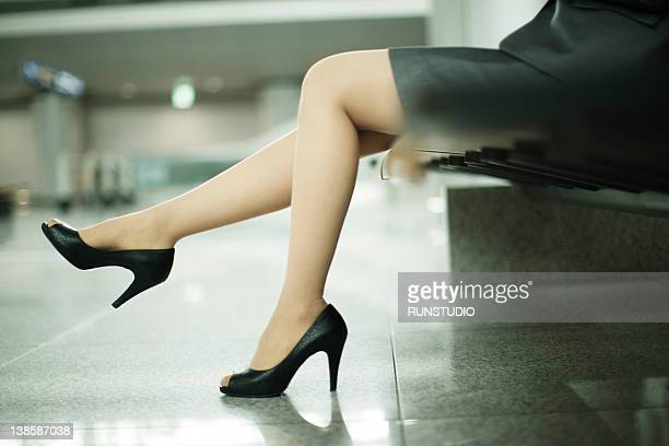 businesswoman in airport - legs and short skirt sitting down stock pictures, royalty-free photos & images
