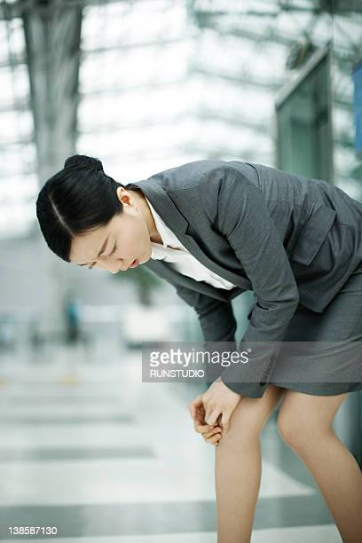 businesswoman in airport - bend over woman stock pictures, royalty-free photos & images