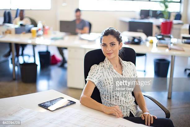 Businesswoman in an open plan office
