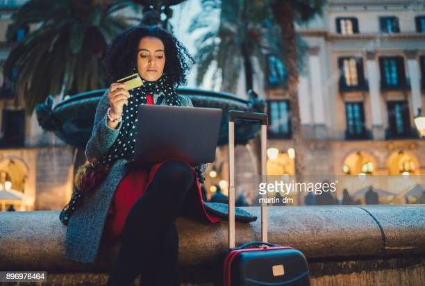 businesswoman in barcelona booking hotel online - making a reservation stock photos and pictures
