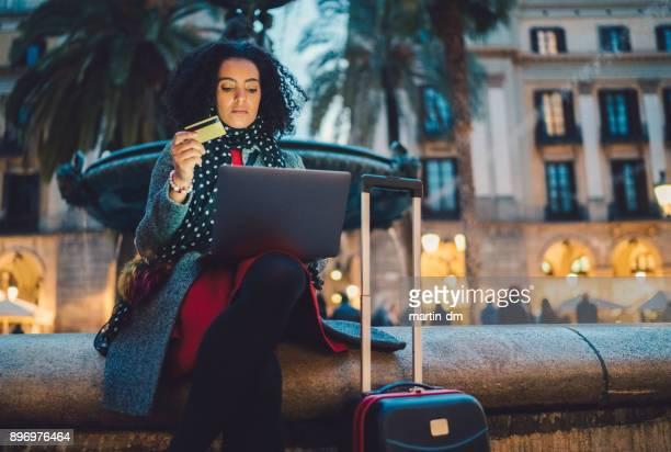 Businesswoman in Barcelona booking hotel online